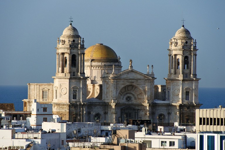 Santa Cruz cathedral towers over the rooftops of Cádiz