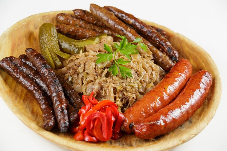 Sausages served with cooked cabbage