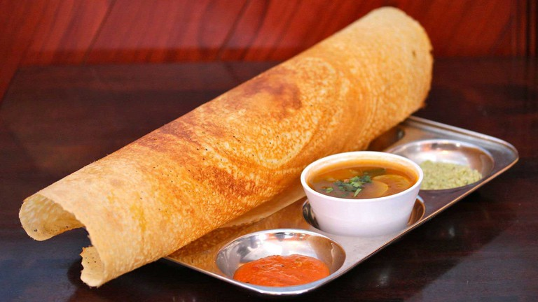 A typical plate of dosa, served at Udipi hotels, with sambhar and two chutneys