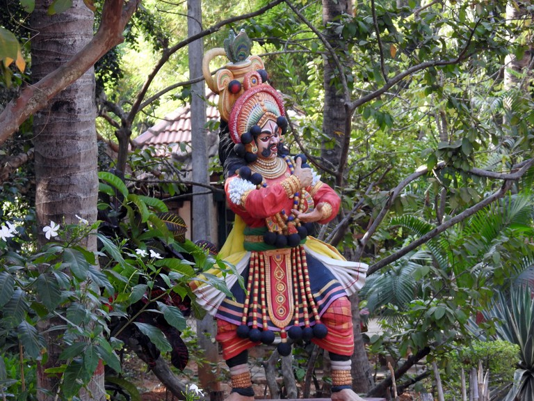 An image of a traditional folk dancer at Janapada Loka