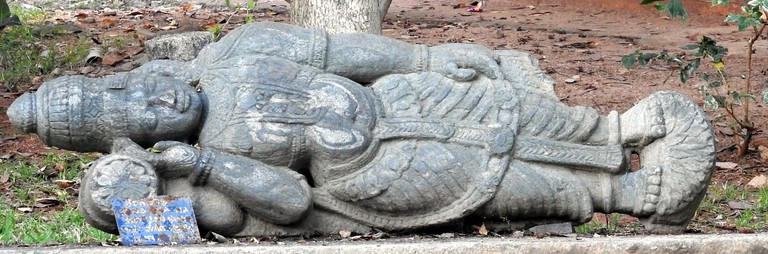 An ancient sculpture of Vishnu in Janapada Loka