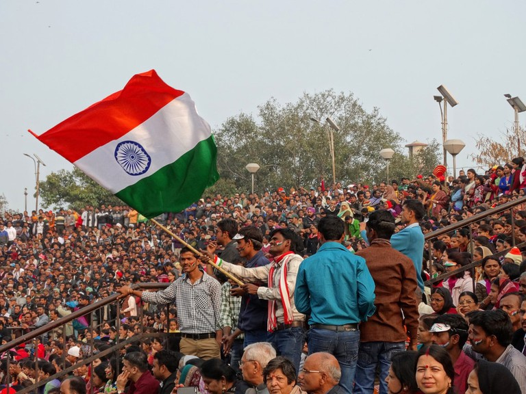 Crowds waving the Indian National Flag during a ceremony at the Attari-Wagah Border Gate