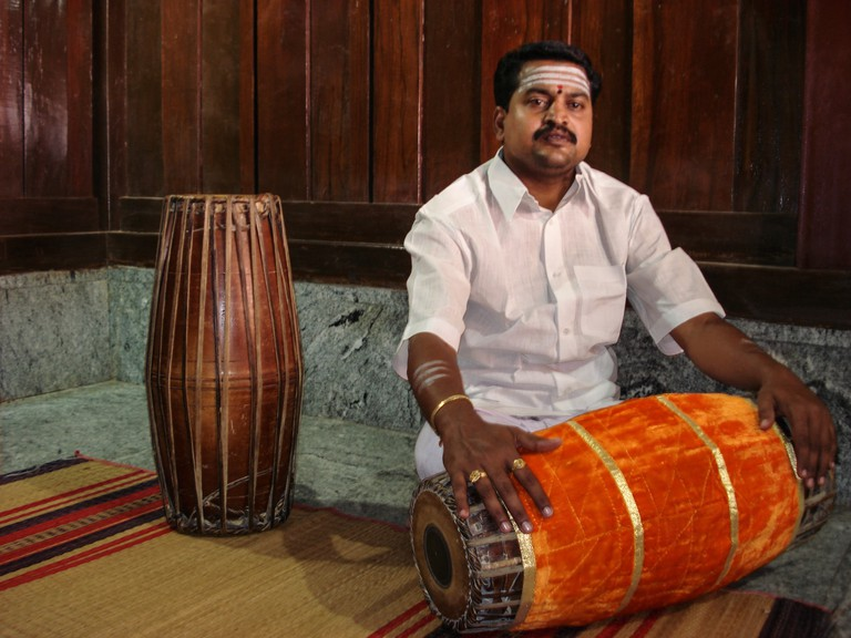 Kodunthirapully Parameswaran, a renowned Carnatic musician with his Mridangam