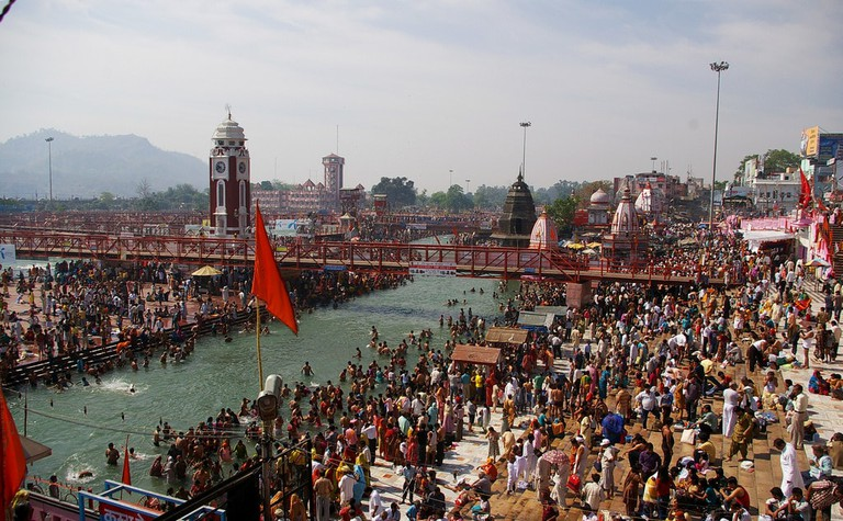 People taking a bath in the Ganges River in Haridwar, India