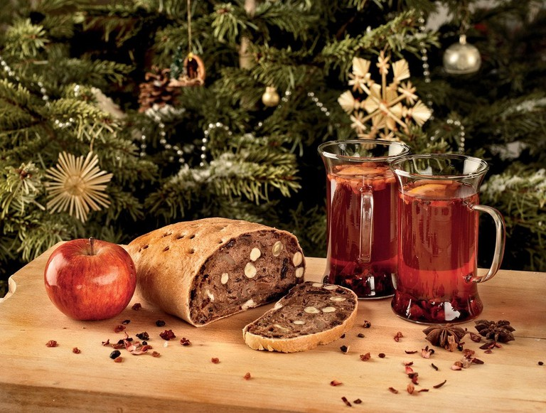 Austrian fruit bread paired with mugs of mulled wine