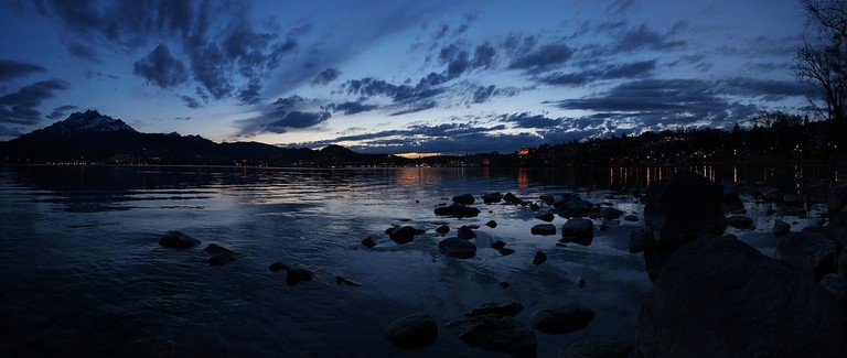 Lucerne begins to glimmer as night falls