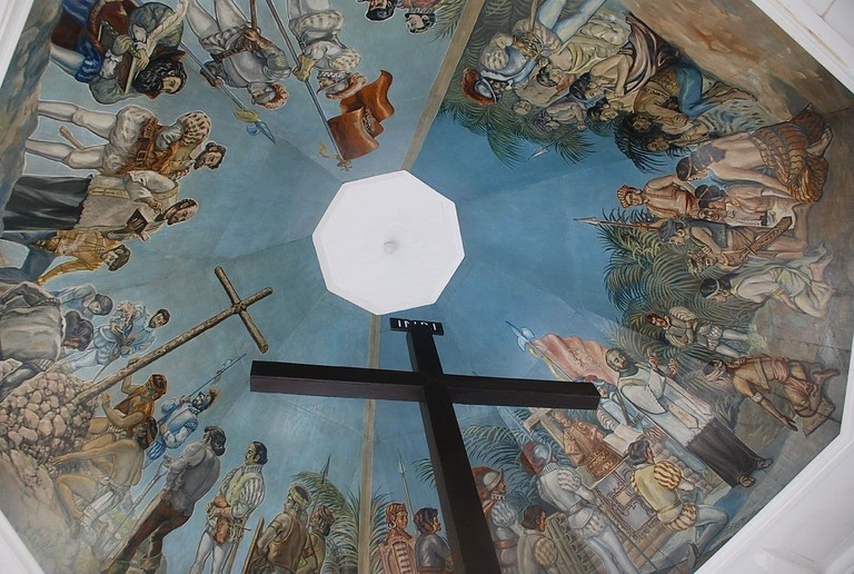 Painting on the ceiling of Magellan's Cross chapel depicting the Catholic baptism