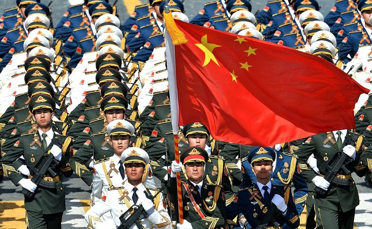Chinese Soldiers March with Flag