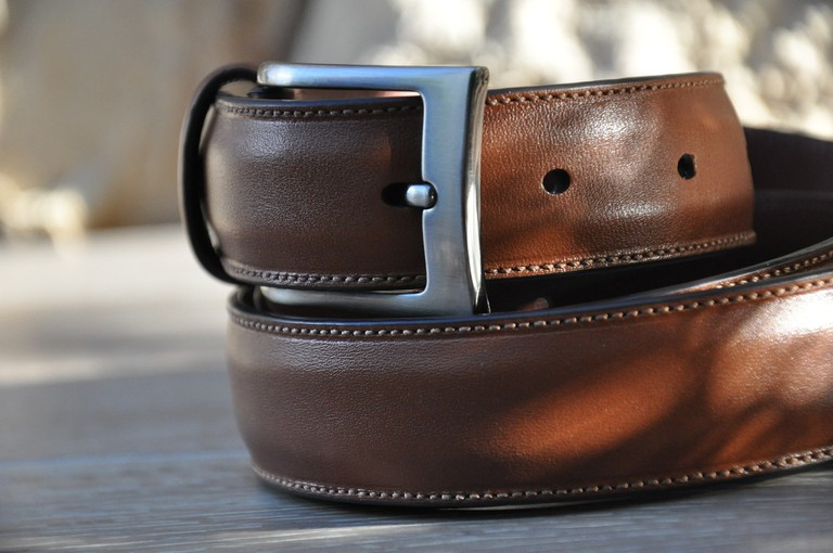 A wrapped-up brown leather belt