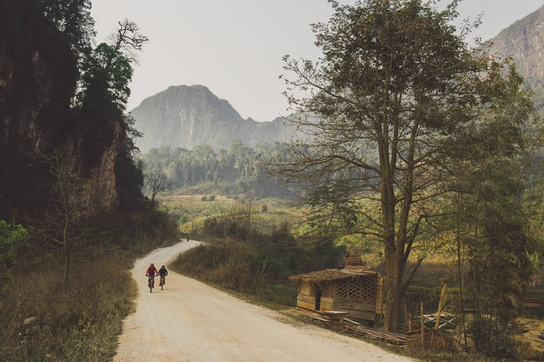 Rebecca Rusch and her riding partner, Huyen Nguyen, pedal the Ho Chi Minh trail.