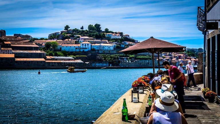 Sit by the Douro River in Porto