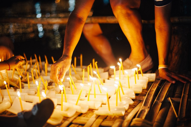 Simple krathong are prepared to float on the river