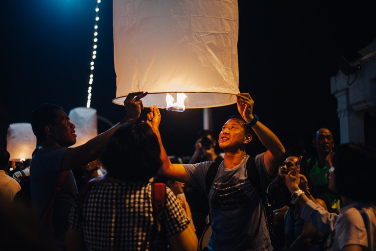 This man's face shows the excitement of releasing a krathong