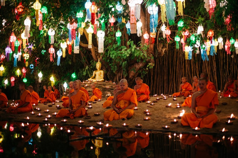 The iconic sight of monks at Wat Phan Tao during Yee Peng festival