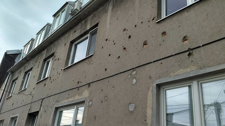 Visible holes from the war on apartment blocks