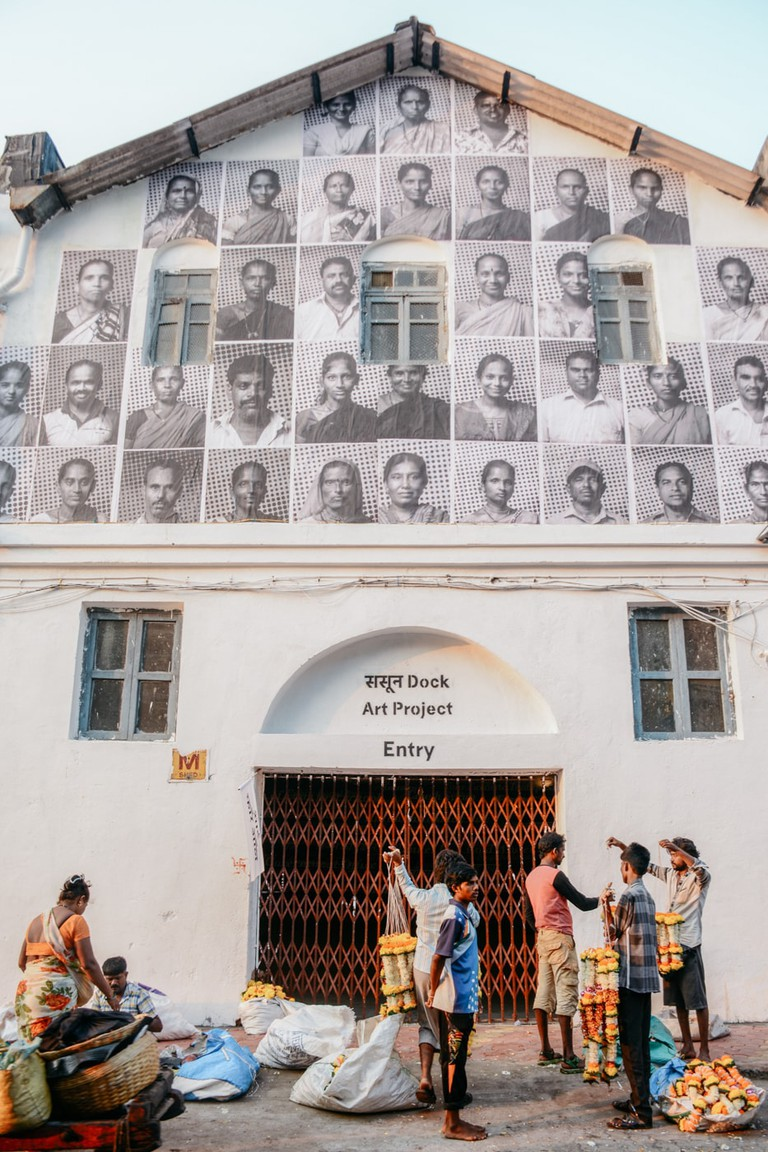 Inside Out's artist covered a building's facade with monochrome portraits of people from the area