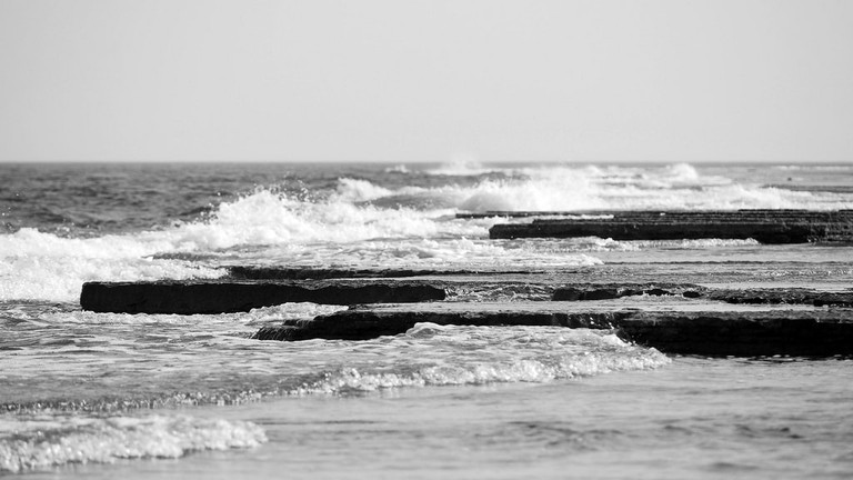 Waves hugging the shore