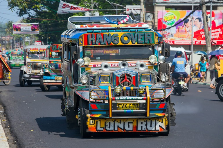 https://www.shutterstock.com/image-photo/legazpi-philippines-march-18-jeepneys-passing-230184337?src=eiLl1a2u4KFwooziMsRF_g-2-3
