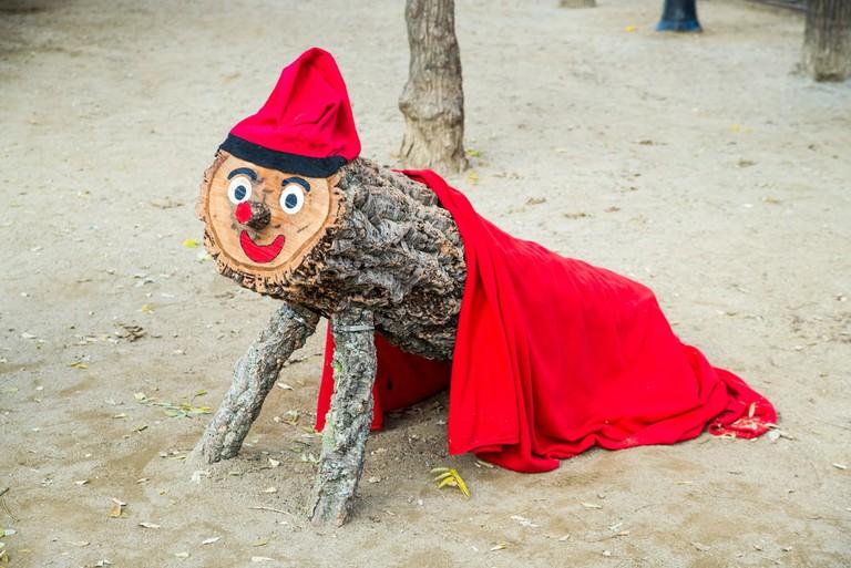Red wooden Tio de Nadal christmas mascot in Barcelona