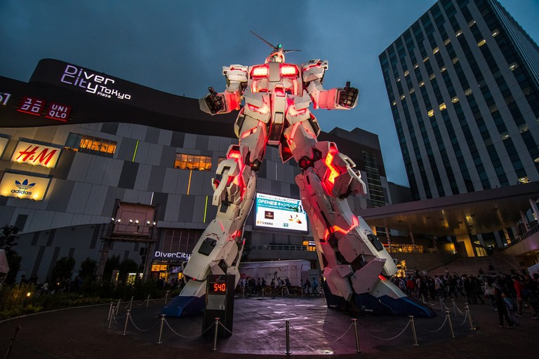 The Gundam known as Unicorn puts on a show outside Diver City in Odaiba