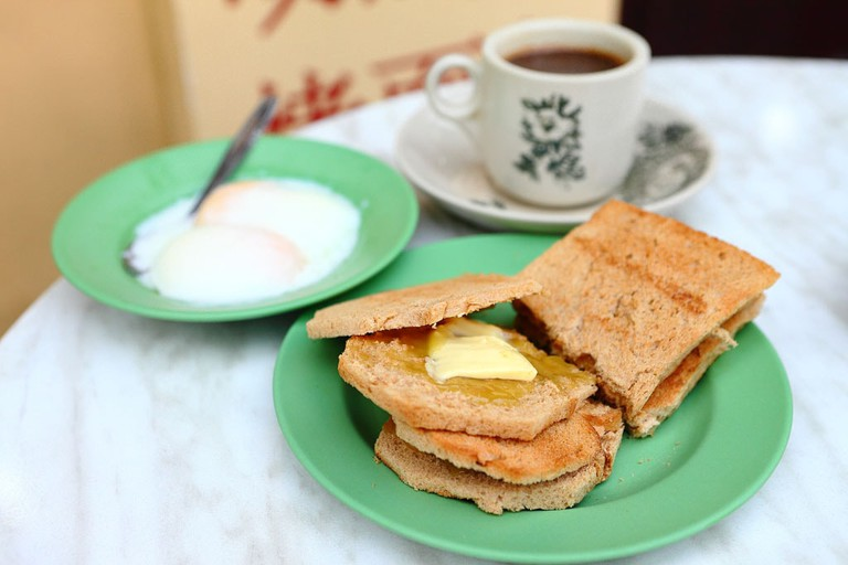 Singapore Breakfast Set: A set of kaya toast with coffee and a plate of half-boiled eggs
