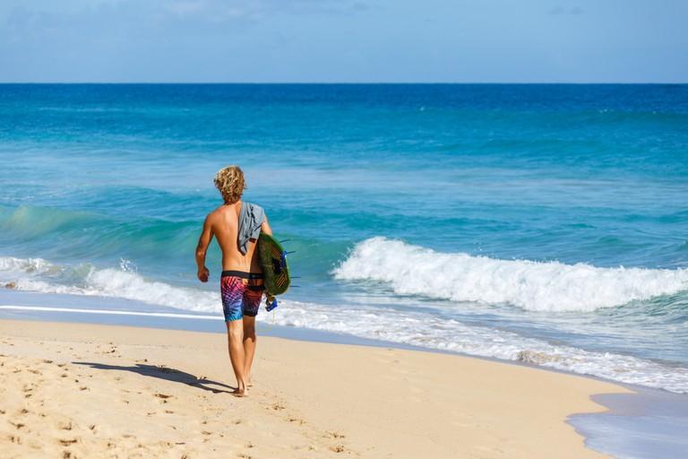 surfer-on-the-beach-public domain