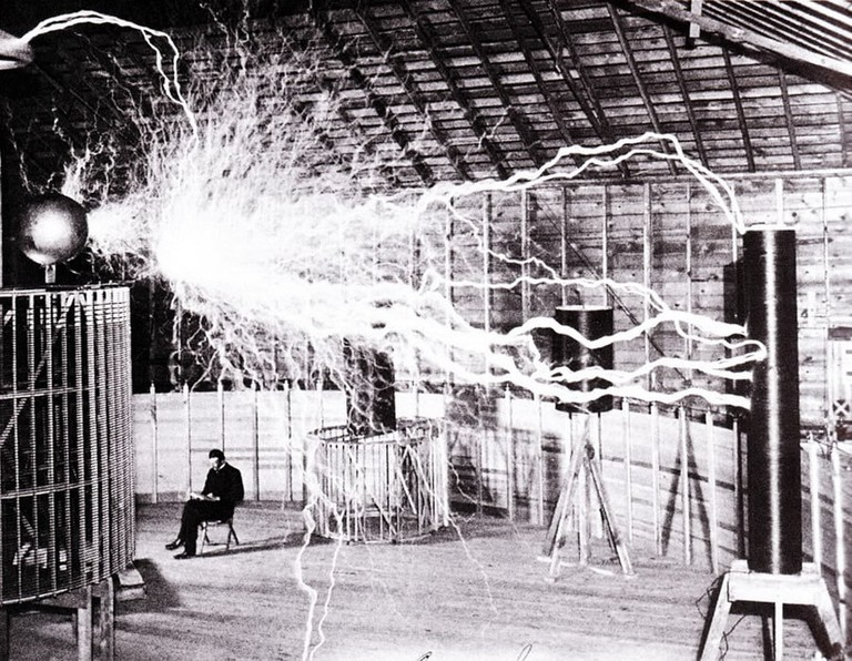 Tesla, just casually hanging out below some rampant electricity