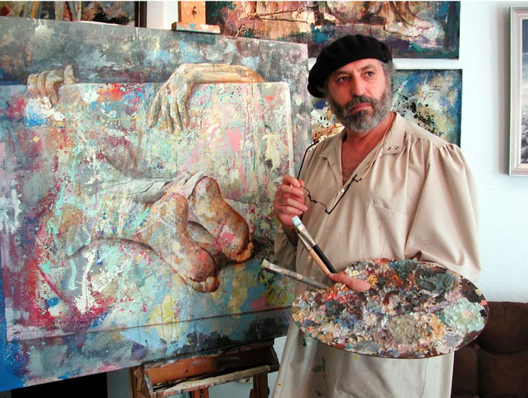 Zoro Mettini painting in a beret