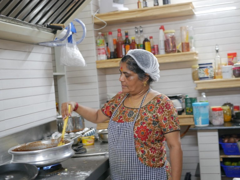 55-year-old Laila Mani in full swing in Mocha At Cafe's kitchen