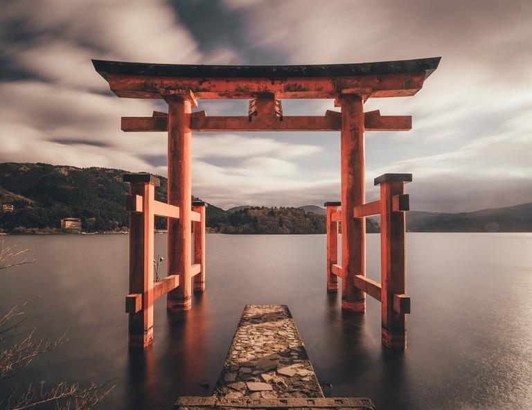 Torii mark the entrance to Shinto shrines