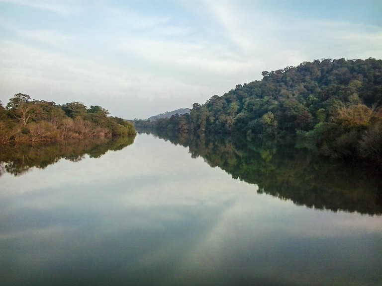 The serene river Tunga that separates the two villages