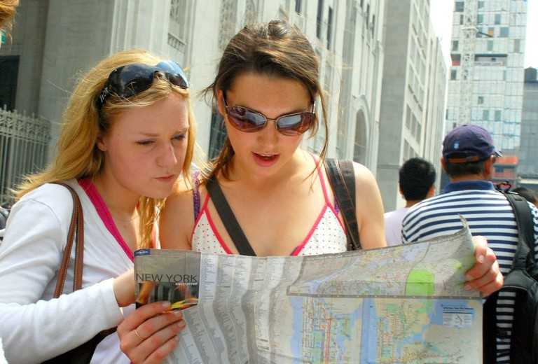 People reading New York City map