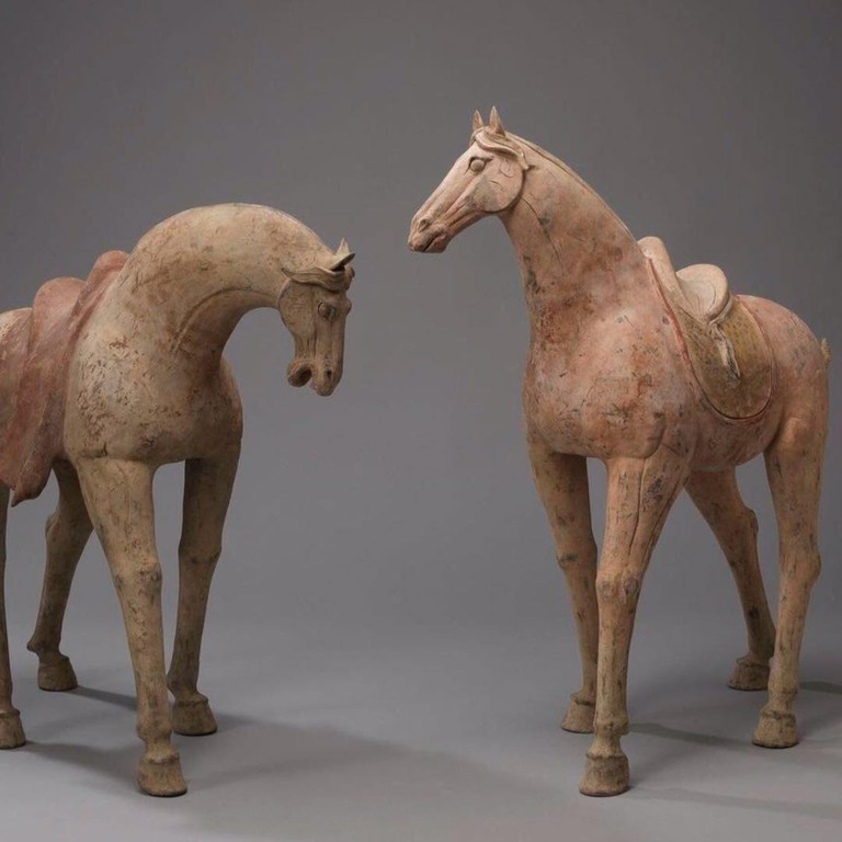 Monolithic pair of painted horses