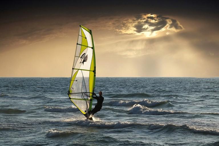 A man windsurfing