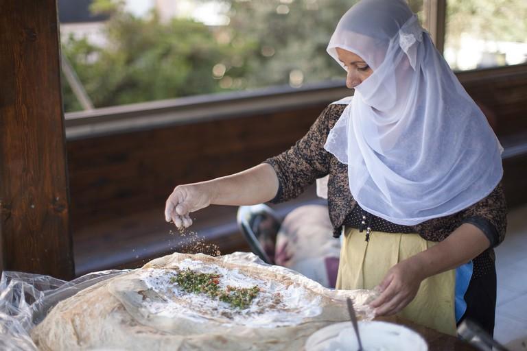 A Druze woman making a classic Druze pita