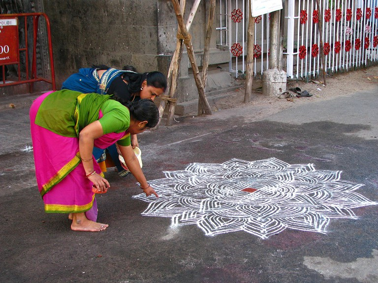 Making rice flour patterns or Kolams is a Tamil tradition common in Mylapore's communities