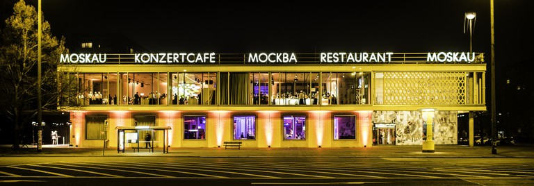 Café Moskau lit up at night