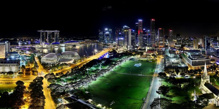 Night view of the Singapore skyline and Padang
