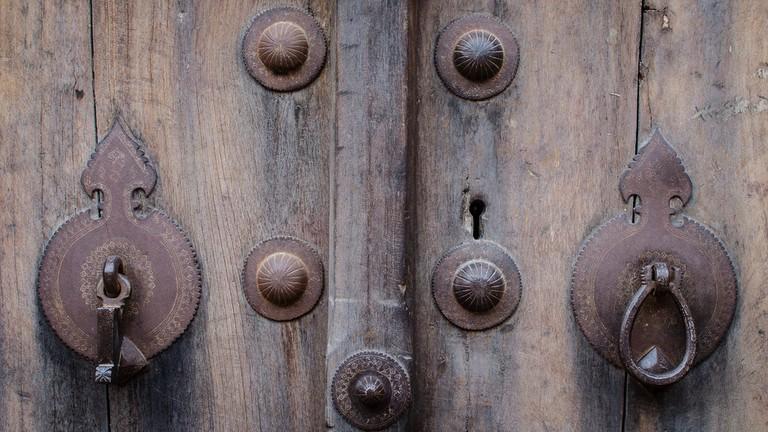 Door knockers of a Muslim household