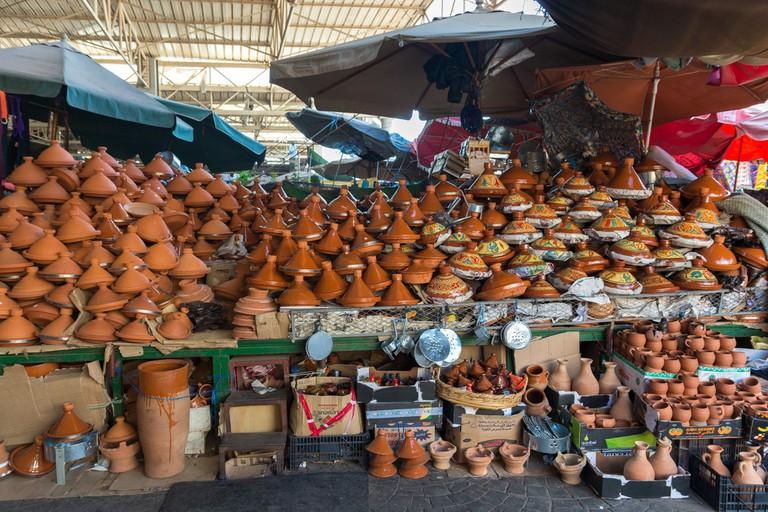 "<a href=""https://www.flickr.com/photos/x-oph/25331493854/"" rel=""noopener"" target=""_blank"">Lots of pottery in Souk El Had, Agadir"