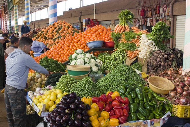 """<a href=""""https://www.flickr.com/photos/thedadys/3217449005/"""" rel=""""noopener"""" target=""""_blank"""">A fruit and vegetable stall in Agadir's Souk El Had"""