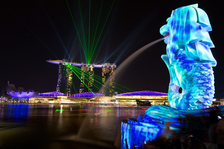 Artistic projections on the Merlion, facing Marina Bay Sands