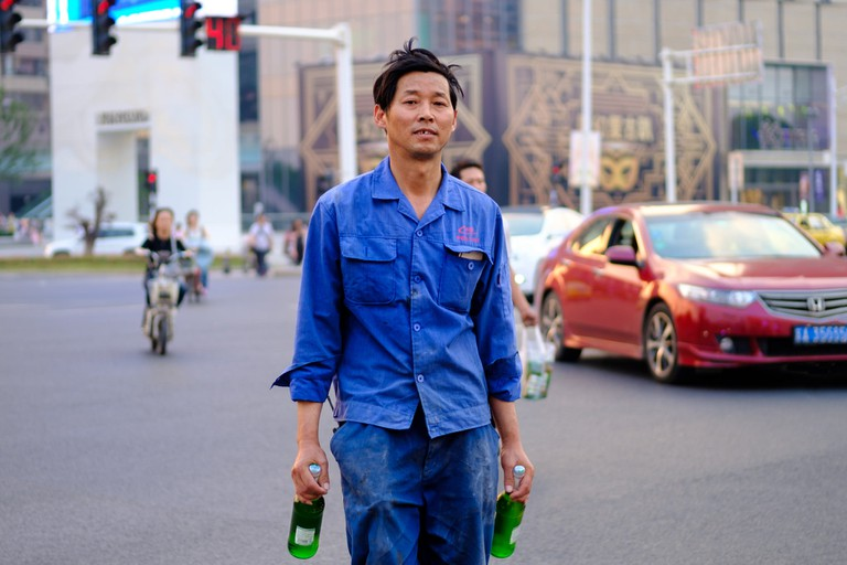 Construction Worker with Chinese Beer