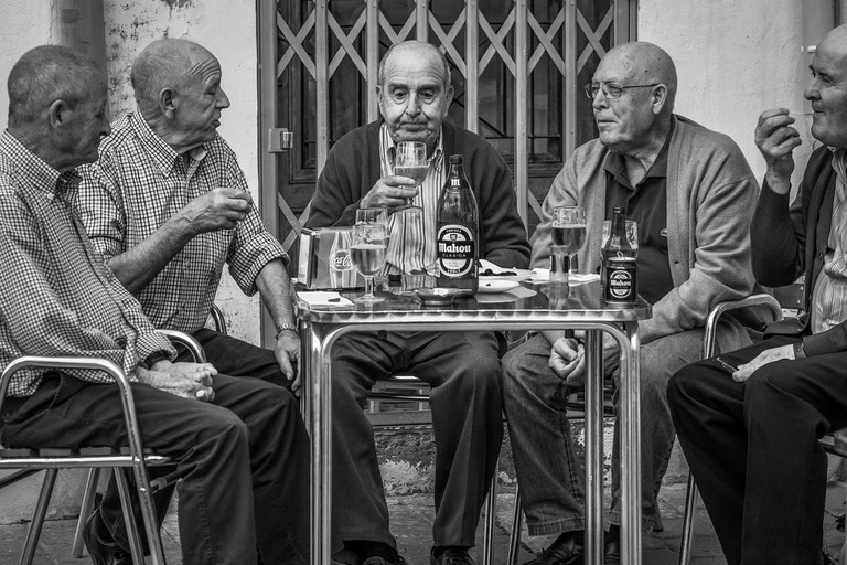 Spanish men enjoying a drink