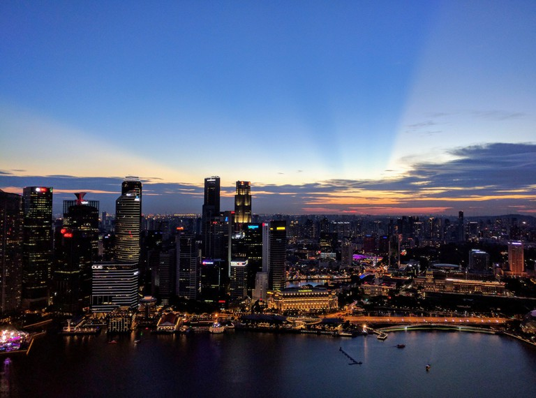 View of Singapore's skyline against a sunset