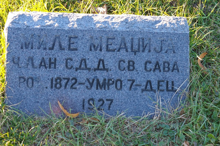 Cyrillic lettering on a tombstone in the US