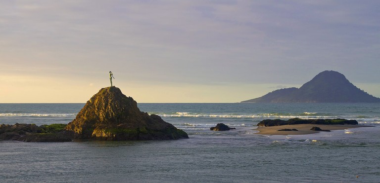 Whakatane's 'Lady on the Rock' with Whale Island in the background