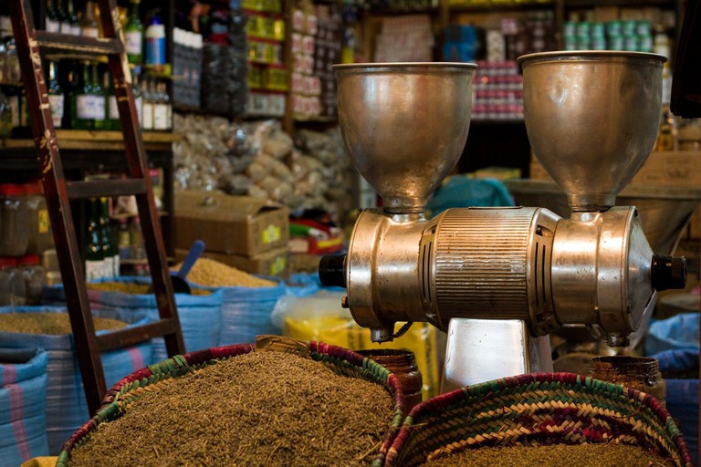 """<a href=""""https://www.flickr.com/photos/dave-white/5710274936/"""" rel=""""noopener"""" target=""""_blank"""">Inside a spice and dry goods shop in Agadir"""
