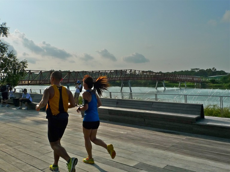 A couple jogs along the Punggol Waterway Park