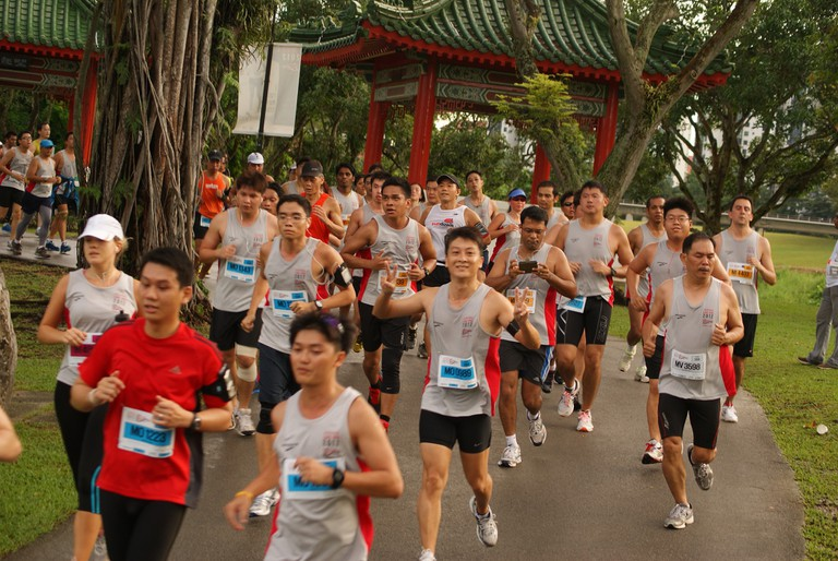 Group of runners passing through Chinese Garden